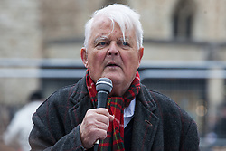 London, UK. 3 May, 2019. Bruce Kent, Vice-President of the Campaign for Nuclear Disarmament (CND), addresses campaigners from CND, Stop the War Coalition, the Peace Pledge Union, the Quakers and other faith groups protesting outside Westminster Abbey against the holding of a National Service of Thanksgiving to mark fifty years of the Continuous at Sea Deterrent (CASD) attended by dignitaries including the Duke of Cambridge and the newly appointed Defence Secretary Penny Mordaunt.