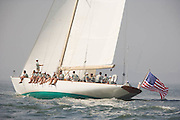 W Class White Wings racing in the Skyline Race at New York Classic Week. Statue of Liberty in the background