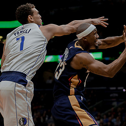 Dec 29, 2017; New Orleans, LA, USA; New Orleans Pelicans forward Dante Cunningham (33) is fouled by Dallas Mavericks forward Dwight Powell (7) during the second half at the Smoothie King Center. The Mavericks defeated the Pelicans 128-120.  Mandatory Credit: Derick E. Hingle-USA TODAY Sports