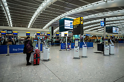 © Licensed to London News Pictures. 10/03/2020. London, UK. A quiet looking Terminal 5 as British Airways cancels all flights to and from Italy over fears of the Coronavirus disease. Photo credit: Alex Lentati/LNP