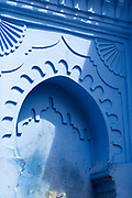 CHEFCHAOUEN, MOROCCO - 27th APRIL 2016 - Close-up of blue water fountain with shadow cast from strong daylight in the Chefchaouen Medina - the blue city - Rif Mountains, Northern Morocco.
