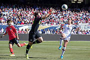 USA forward Carli Lloyd (10) races to the ball while South Korea goalie defends during an international friendly in Chicago, Sunday, Oct. 6, 2019, in Chicago. USWNT tied the Korea Republic 1-1. (Max Siker/Image of Sport)