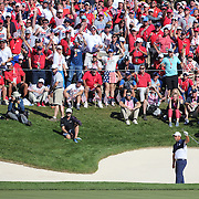 Ryder Cup 2016. Day Three. Patrick Reed of the United States reacts along with the crowd as he chips out of the sand trap on the sixteenth during his win against Rory McIlroy of Europe in the Sunday singles competition at  the Ryder Cup tournament at Hazeltine National Golf Club on October 02, 2016 in Chaska, Minnesota.  (Photo by Tim Clayton/Corbis via Getty Images)