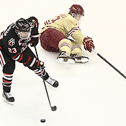 Colton Saucerman #23 of the Northeastern Huskies skates  with the puck during The Beanpot Championship Game at TD Garden on February 10, 2014 in Boston, Massachusetts. (Photo by Elan Kawesch)