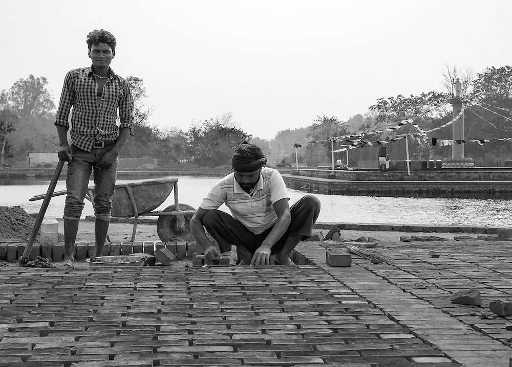 Bricklayers in Lumbini Gardens practicing their trade