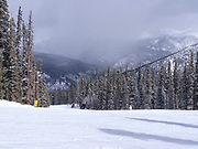 People skiing and preparing to ski at Keystone Ski Resort, Keystone, Colorado, USA.