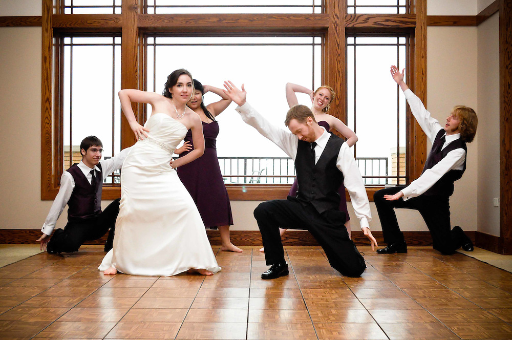 Cailtin & Alex's bridal party joins them for a theatrical choreographed dance at The Highlands on Elgin, Elgin, IL