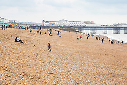 © Licensed to London News Pictures. 05/10/2019. Brighton, UK. A handful of visitors can be seen on an almost empty beach in Brighton and Hove as grey and colder weather is hitting the seaside resort. Photo credit: Hugo Michiels/LNP