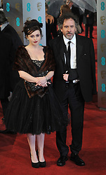 Helena Bonham Carter with her director partner Tim Burton. arrives at the British Academy Film Awards, The Royal Opera House, Bow Street, London, UK, Sunday February 10, 2013. Photo by Andrew Parsons / i-Images