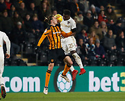 Ronaldo Vieira of Leeds United and Jackson Irvine of Hull City contest an aerial ball during the EFL Sky Bet Championship match between Hull City and Leeds United at the KCOM Stadium, Kingston upon Hull, England on 30 January 2018. Photo by Paul Thompson.