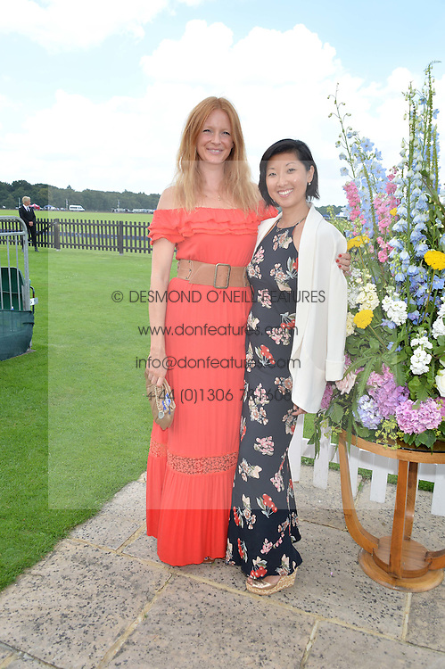 Left to right, OLIVIA INGE and BEATRIX ONG at The Royal Salute Coronation Cup Polo held at Guards Polo Club,  Smiths Lawn, Windsor Great Park, Egham on 23rd July 2016.