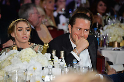 JAMES STUNT and PETRA ECCLESTONE at the Caudwell Children's annual Butterfly Ball held at The Grosvenor House Hotel, Park Lane, London on 15th May 2014.