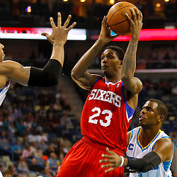 January 3, 2011; New Orleans, LA, USA; Philadelphia 76ers point guard Lou Williams (23) is defended by New Orleans Hornets point guard Chris Paul (3) and power forward David West (30) during the first quarter at the New Orleans Arena.   Mandatory Credit: Derick E. Hingle