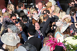 A racegoer sings along at the bandstand after the racing on day three of Royal Ascot at Ascot Racecourse.