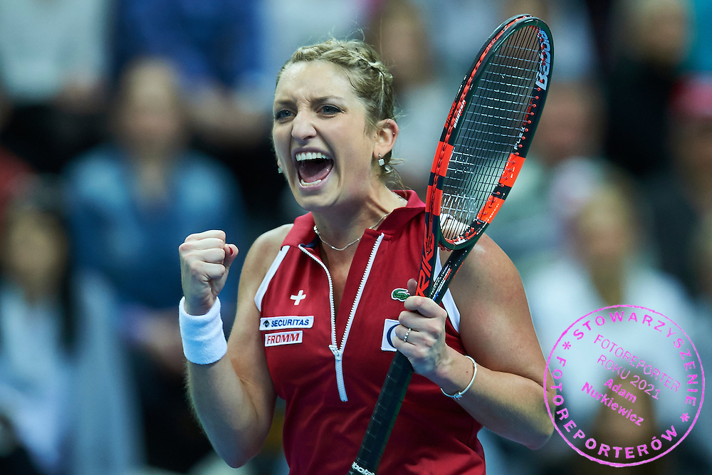 Timea Bacsinszky from Switzerland celebrates after victory her match during the Fed Cup / World Group Play Off tennis match between Poland and Switzerland on April 18, 2015 in Zielona Gora, Poland<br /> Poland, Zielona Gora, April 18, 2015<br /> <br /> Picture also available in RAW (NEF) or TIFF format on special request.<br /> <br /> For editorial use only. Any commercial or promotional use requires permission.<br /> <br /> Adam Nurkiewicz declares that he has no rights to the image of people at the photographs of his authorship.<br /> <br /> Mandatory credit:<br /> Photo by &copy; Adam Nurkiewicz / Mediasport