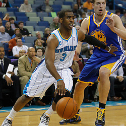 January 5, 2011; New Orleans, LA, USA; New Orleans Hornets point guard Chris Paul (3) drives past Golden State Warriors center David Lee (10) during the first quarter at the New Orleans Arena.   Mandatory Credit: Derick E. Hingle