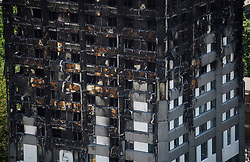 © Licensed to London News Pictures. 17/06/2017. London, UK. Image showing burnt cladding following a fire at the Grenfell tower block in west London earlier this week. The blaze engulfed the 27-storey building killing 12 - with 34 people still in hospital, 18 of whom are in critical condition. The fire brigade say that they don't expect to find anyone else alive. Photo credit: Ben Cawthra/LNP