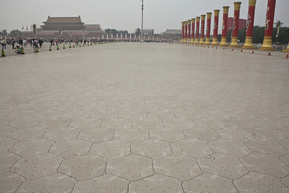 On Tiananmen square a special material has been installed to receive the military vehicles during the celebrations of the People's Republic of China this first october. On the right side, 56 columns have specially been erected to symbolizes the 56 chinese minorities (including Taiwan). September 27 2009.