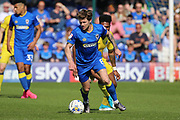 AFC Wimbledon midfielder Jake Reeves (8) holding up ball from Bristol Rovers striker Ellis Harrison (9) during the EFL Sky Bet League 1 match between AFC Wimbledon and Bristol Rovers at the Cherry Red Records Stadium, Kingston, England on 8 April 2017. Photo by Matthew Redman.