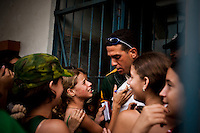 Teenage girls approach a member of the Pinar del Rio baseball team outside the stadium during a pause in the game from rain storm during game two of the National Series, in Pinar del Rio, on Sunday, April 20, 2008. ..When music and dancing are the rhythm and soul of life on this island nation, baseball is the passion. It gives Cubans something to dance to and something to cheer for when there's little else. It's what makes them feel free of government politics...Baseball is everywhere – in the streets, on TV, or empty fields. It's in conversation over peso pizza or debates in the Central Plaza. .