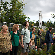Anti-fracking activists join hands to surround the Cuadrilla fracking site. Thousands turned out for a march of solidarity against fracking in Balcombe. The village Balcombe in Sussex is the  centre of fracking by the company Cuadrilla. The march saw anti-fracking movements from the Lancashire and the North, Wales and other communities around the UK under threat of gas and oil exploration by fracking.