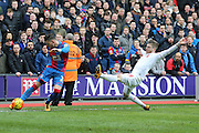 Crystal Palace defender Joel Ward  clears ahead of Liverpool defender Alberto Moreno (18)  during the Barclays Premier League match between Crystal Palace and Liverpool at Selhurst Park, London, England on 6 March 2016. Photo by Simon Davies.