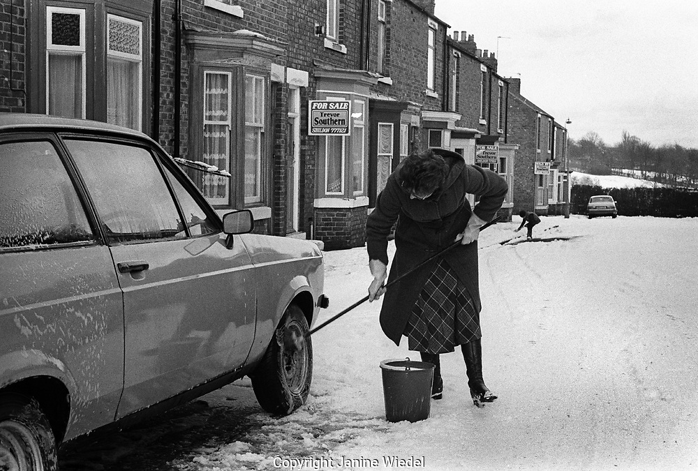 woman washing her car in street in small town of Shilden in County Durhan in the North of England where unemployment hit hard in the mid-1980s