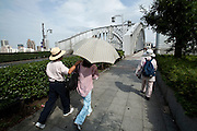 Couple walking towards a bridge over Sumida river