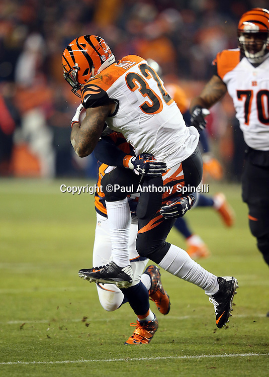 Cincinnati Bengals running back Jeremy Hill (32) gets jacked up by Denver Broncos inside linebacker Danny Trevathan (59) as he runs the ball in the second quarter during the 2015 NFL week 16 regular season football game against the Denver Broncos on Monday, Dec. 28, 2015 in Denver. The Broncos won the game in overtime 20-17. (©Paul Anthony Spinelli)