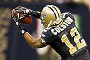 NEW ORLEANS, LA - DECEMBER 26:   Marques Colston #12 of the New Orleans Saints catches a pass against the Atlanta Falcons at Mercedes-Benz Superdome on December 26, 2011 in New Orleans, Louisiana.  The Saints defeated the Falcons 45-16.  (Photo by Wesley Hitt/Getty Images) *** Local Caption *** Marques Colston