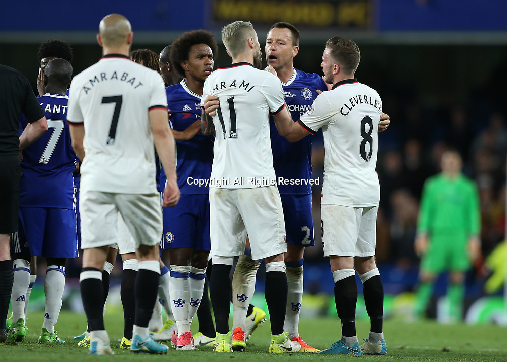 May 15th 2017, Stamford Bridge, London, England; EPL Premier League football, Chelsea FC versus Watford; John Terry, the Chelsea captain and Willian of Chelsea trying to calm Valon Behrami of Watford and Tom Cleverley of Watford down