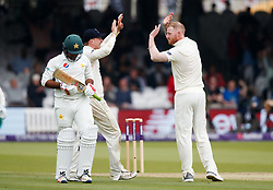 England's Ben Stokes (right) celebrates the wicket of Pakistan's Sarfraz Ahmed during day two of the First NatWest Test Series match at Lord's, London.