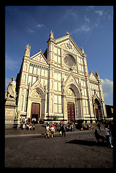 Florence, Italy: The dramatic Gothic styling of Santa Croce makes it one of the most distinguished in Florence.  Inside re the tombs of Michelangelo, Galileo, and Machiavelli, and it also is well known for its glowing, early 14th century frescos.