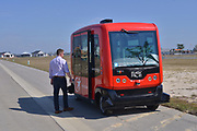 The red vehicle is a driverless autonomous shuttle which ferries people around the town.<br /> Babcock Ranch is America's first solar powered eco-town. 170 miles NW of Miami, near Fort Myers it is estimated to grow to  population of 50,000 people. Like a small town it will have its own schools offices and medical facilities as well as shops and restaurants.<br /> Syd Kitson, the founder was a former NFL football player turned property developer.