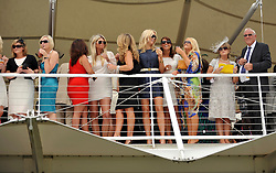 © licensed to London News Pictures. LONDON, UK.  28/07/11. Ladies day at Glorious Goodwood on 28 July 2011. More than 100,000 people flock through the gates of Glorious Goodwood to enjoy the atmosphere. There are racing highlights every day - including the Sussex Stakes, the Goodwood Cup and the Markel International Nassau Stakes.Mandatory Credit Stephen Simpson/LNP