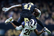 NEW ORLEANS, LA - NOVEMBER 4:  Alvin Kamara #41 of the New Orleans Saints runs the ball and leaps over Lamarcus Joyner #20 of the Los Angeles Rams at Mercedes-Benz Superdome on November 4, 2018 in New Orleans, Louisiana.  The Saints defeated the Rams 45-35.  (Photo by Wesley Hitt/Getty Images) *** Local Caption *** Alvin Kamara; Lamarcus Joyner