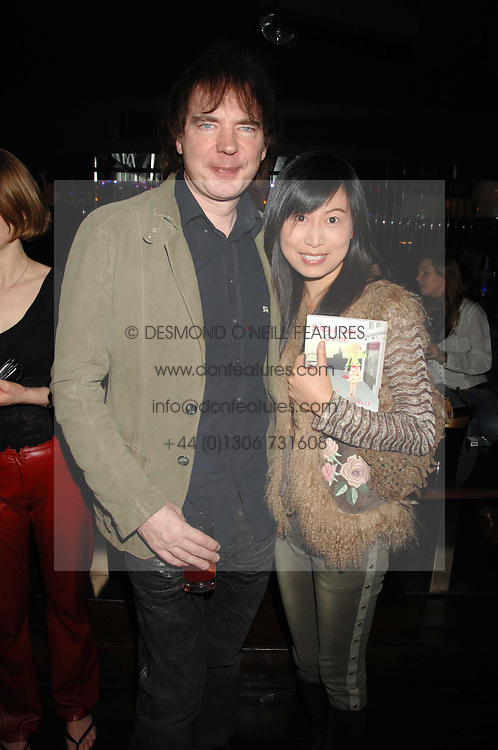 JULIAN LLOYD WEBBER and his girlfriend at a party to celebrate Imogen Lloyd Webber's 30th birthday and the launch of her Single Girl's Guide held at Vilstead, 9 Swallow Street, London on 27th March 2007.<br /><br />NON EXCLUSIVE - WORLD RIGHTS