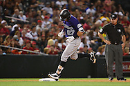 Apr 29, 2016; Phoenix, AZ, USA; Colorado Rockies shortstop Trevor Story (27) rounds third base after hitting a two run home run against the Arizona Diamondbacks in the fifth inning at Chase Field. Mandatory Credit: Jennifer Stewart-USA TODAY Sports