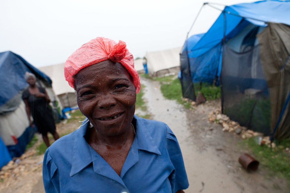 Odette Thalerin poses for a picture. The tent city where Thalerin lives was damaged in the wind and rain from hurricane Tomas.