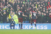 Norwich Citys Bradley Johnson celebrates with fans after scoring his side's opening goal during the Sky Bet Championship match between Brighton and Hove Albion and Norwich City at the American Express Community Stadium, Brighton and Hove, England on 3 April 2015.