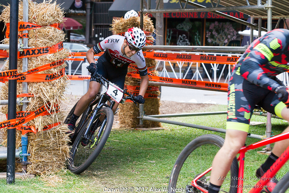 Alberto Mingorance Fernández (#4 ESP) is just off Simon Rogier's (FRA) rear wheel as they come through the turns under the bridge during the last lap of the finals at the UCI Mountain Bike Eliminator World Cup held in  Columbus, GA, USA on June 4, 2017.