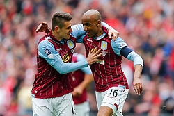 Fabian Delph of Aston Villa celebrates with Ashley Westwood after scoring a goal to make it 2-1 - Photo mandatory by-line: Rogan Thomson/JMP - 07966 386802 - 19/04/2015 - SPORT - FOOTBALL - London, England - Wembley Stadium - Aston Villa v Liverpool - FA Cup Semi Final.