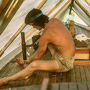 When we first bought the sailboat from the builder, a highly skilled English shipwright called Jim, he had painted the deck with black bitumastic paint as a drastic last resort to stop the mahogany deck leaking. It worked but created such a horrible mess on our hands and clothes, or anything that came into contact with it so we had to bite the bullet and scrape it all off, and what a horrible job that was! We then had to recaulk it in the old traditional way, and seal it with sealant using a sealant gun, which was also a horribly messy job. It was the first time that I had done anything like that before. The final sealing with sealant wasn't very successful because the seams opened up so much in hot dry weather, and the deck always leaked to some degree in different places. Apparently mahogany isn't the ideal choice for decking because it shrinks and swells too much.