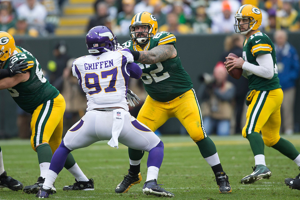 GREEN BAY, WI - DECEMBER 2:  Evan Dietrich-Smith #62 of the Green Bay Packers blocks Everson Griffen #97 of the Minnesota Vikings at Lambeau Field on December 2, 2012 in Green Bay, Wisconsin.  The Packers defeated the Vikings 23-14.  (Photo by Wesley Hitt/Getty Images) *** Local Caption *** Evan Dietrich-Smith; Everson Griffen
