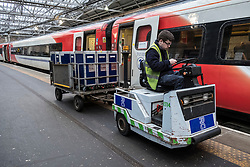 Food and beverage services being loaded onto Virgin Trains service to London King's Cross on East Coast Main line  at platform at Waverley Station in Edinburgh, Scotland, United Kingdom