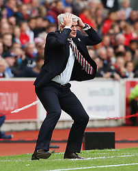 Stoke City manager Mark Hughes reacts in frustration towards referee Mike Dean - Mandatory by-line: Matt McNulty/JMP - 20/08/2016 - FOOTBALL - Bet365 Stadium - Stoke-on-Trent, England - Stoke City v Manchester City - Premier League