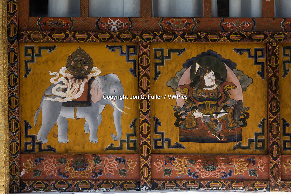 Buddhist religious paintings, including a Dharma Wheel on the back of an elephant on the Buddhist temple in Punakha, Bhutan