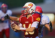 Marion's Trevor Hardman (16) is sacked by Decorah's Michael Peter (82) during the game between the Decorah Vikings and the Marion Indians at Thomas Park in Marion on Friday, August 31, 2012.