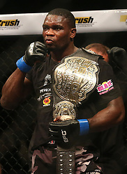 Dalcha Lungiambula (Blue) celebrates winning the Interim Light Heavyweight Title during the Interim Light Heavyweight Title bout of the Extreme Fighting Championships, EFC 52 held at the Grand West Casino in Cape Town, South Africa on the 5th August 2016<br /> <br /> Photo by:   Shaun Roy / Real Time Images
