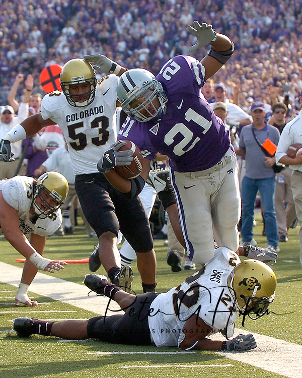 Kansas State running back Carlos Alsup (21) is knocked out of bounds at the Colorado three yard line after a 23-yard gain, by the Buffs Byron Ellis (22) in the third quarter at KSU Stadium in Manhattan, Kansas, October 29, 2005.  The Buffaloes beat K-State 23-20.